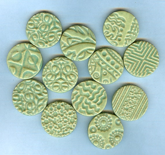 2 dollars off..............handmade embossed round tiles with matte green glaze