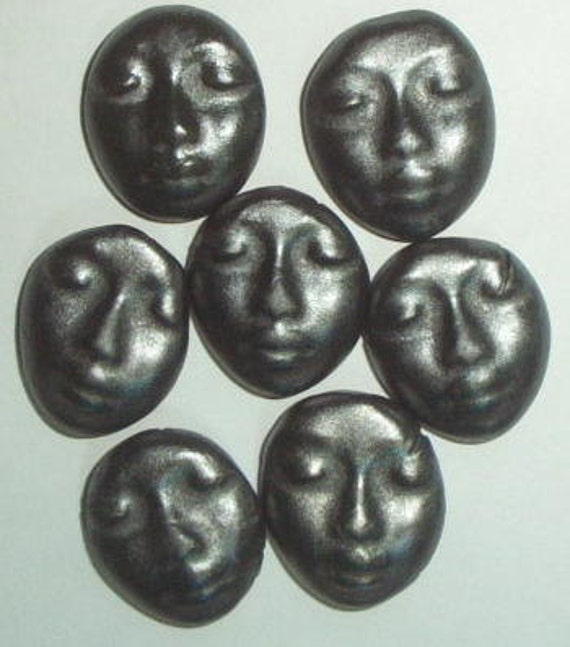 black ceramic faces...burnished steel matte glaze