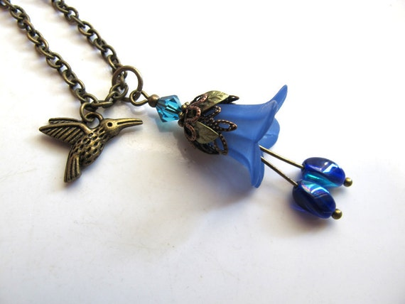Romantic Spring Summer Nature Inspired Humming bird and Blue Lily Flower, Swarovski Crystal, oval twist Czech glass Necklace