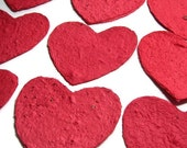 Heart-shaped red tags made of plantable handmade paper embedded with perennial and annual flower seeds