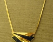 Vtg. Monet (Signed) Gold Serpentine Chain Necklace with Dk. Blue/Gold Pendant