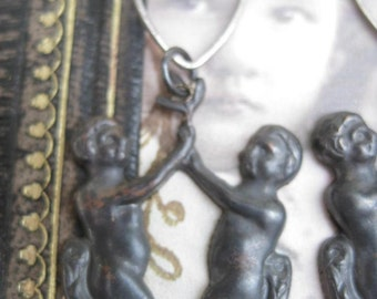 the Garden -- antique Adam and Eve stampings crystal heart deco dangles