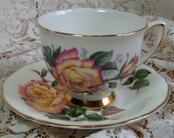 "Cup and saucer, Adderley, Fine Bone China of England  ""Peace"" Colclough E7 numbered"