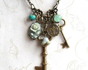 Long key necklace, charm necklace, sage green, fleur de lis charm, skeleton key