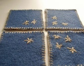 Set of 4 felted blue coasters, made from upcycled wool sweater, hand embroidered in beige with primitive stars design