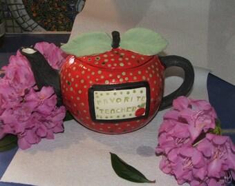 Red Favorite Teacher Teapot On Blackboard shaped like an Apple