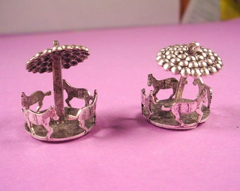 2 silver ox merry go round charms spins