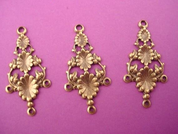 4 brass ox  pod floral charms open cut triple loop chandelier
