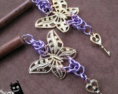 purple and gold butterfly hair sticks