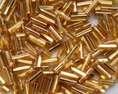 Czech Republic, 7mm Gold Glass Bugle Beads, 20 grams
