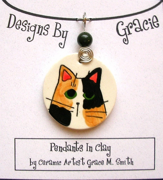 Calico Cat Face On Clay Pendant Handmade With Wire Wrap and Stone Bead