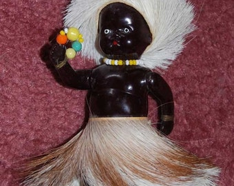 Black Native Doll with Fur Hat and Skirt- Hard Plastic - 1950 s Era - Unusual One..