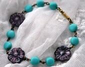 Spring flower colors bracelet: Purple Czech glass flowers, antique Czech glass opaque aqua blue oval beads, vintage brass clasp