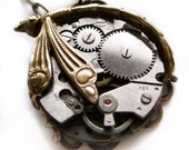 Steampunk necklace, Dragonfly necklace encasing a watch mechanism steampunk jewelry