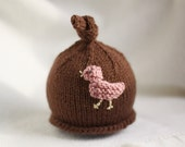 Baby girl or boy knit hat with bird applique.  Sizes newborn to big kid available.
