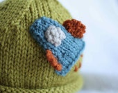 Baby boy knit hat with rocket ship applique.  Sizes newborn to big kid available.