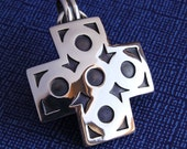 Sterling Silver Cross Pendant with Circle Designs