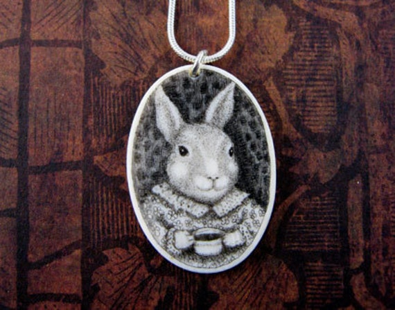 Original scrimshaw bunny rabbit on  ivory pendant with coffee