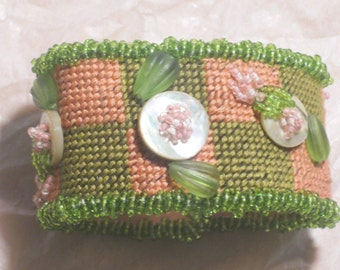 Pink and Green Needlepoint Bracelet\/w Mother of preal buttons,press glass,seed beads
