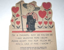 Vintage Rosen Co. Lollypop or Sucker Holder Valentine Card with Little Farmer Boy and Anthropomorphic Heart Flowers by E. Rosen Co.