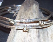 Organic Sterling and 14kt gold notched bangle