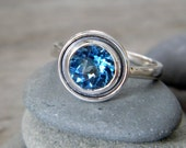 Swiss Blue Topaz Halo Ring in Tarnish Resistant Sterling, Made In Your Size
