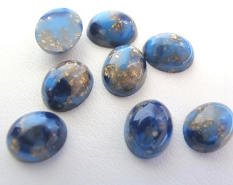 8 Teeny Vintage Lucite Cabs 8 x 9.5 mm Gold and Medium Blue flecks in Deep Sapphire Blue