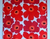 Kitchen Tea Towel made with a marimekko style fabric bold bright red flowers