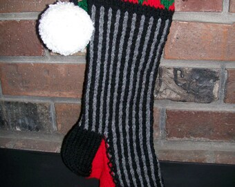 Old Fashioned Hand Knit Black Gray Vertical Stripe Christmas Stocking with White Flower Red Green Borders
