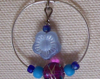 Purple and blue beaded hoop earrings