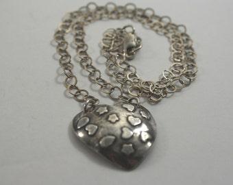 Handmade Antiqued Precious metal clay embossed heart