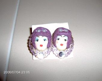 girl face earrings