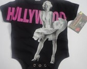 NWT black bodysuit or tee of marlyn hollywood. available in all of our sizes listed.