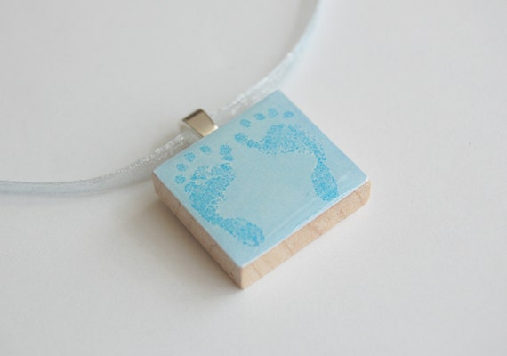 SALE -- Tiny Toes Baby Blue Footprints pendant