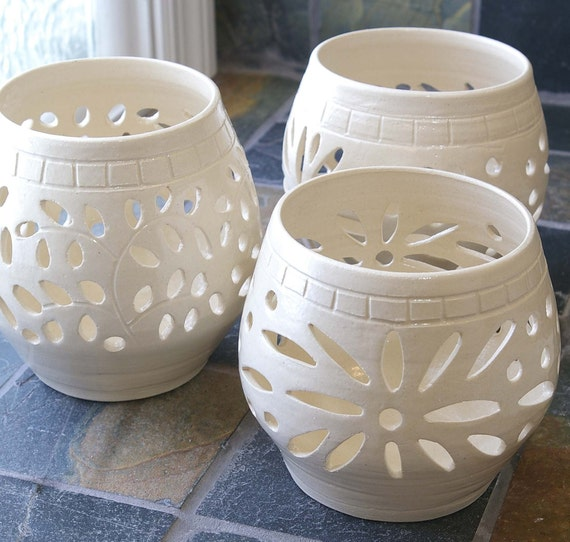 White ceramic candle holders are among the hottest decorating trends now. The popular contemporary designs, with intricate carved-out patterns, create a truly magical ambiance as the candlelight shines through the multiple holes and gaps.