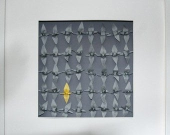 Grey origami crane art with the coloured odd one out
