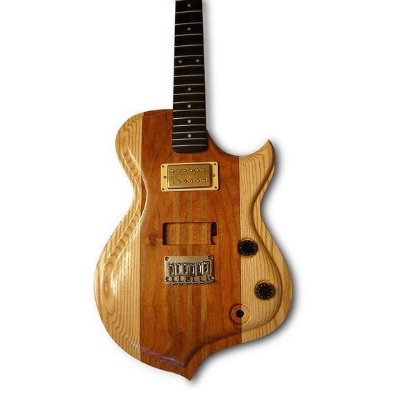 Items similar to handmade electric wood guitar ash