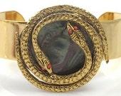 Orange Eye Serpent Gold Cuff Bracelet