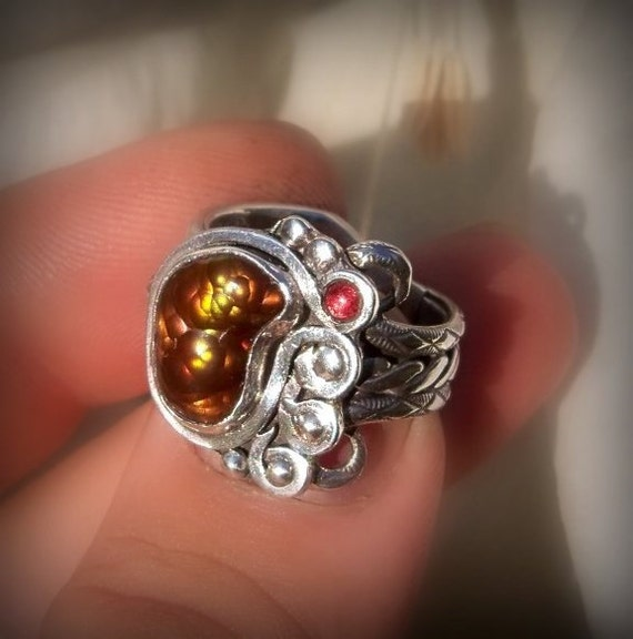 Favor of Kane  Fire agate set in a sterling silver handcrafted ring  with Red garnet accent stone