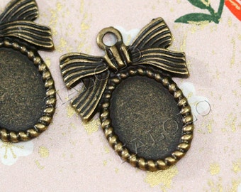 8pcs antique bronze oval bow ribbon bezel base pendant - oval pad inner size is 14x10mm. BN285