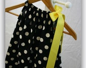 The Black with Large White Polka Dots Pillowcase Dress with a Large Yellow Bow over one Shoulder