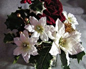 Christmas Rose Floral Arrangement deep red, fully opened, velvety rose surrounded by white poinsettias