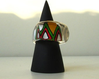 Transparent acrylic ring with a big M