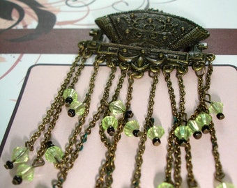 Vintage brooch with lime green faceted beads