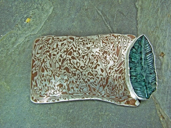 mokume gane  pin with carved stone