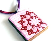 Red circle lace on pink wood pendant
