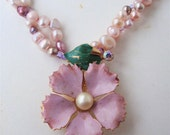 Vintage enamel flower  brooch converted to a pendant for this dyed fresh water pearl necklace with tiny swarovski crystals.
