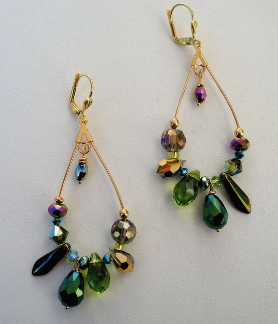 Gold elongated hoop earrings with green and gold crystals and glass beads with highlights of pink. Very light weight and fun to wear. 2""