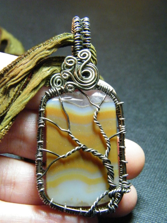 Tree Of Life: Woven wire TreeOf Life on an Agate slice with a hand dyed silk ribbon, necklace