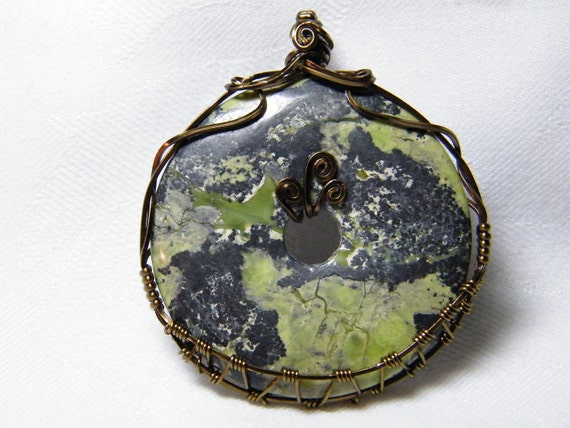 Magnetite: Large woven wire wrapped natural Magnetite donut pendant